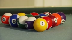 Billiard balls being hit on pool table Stock Footage