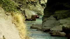 Tourists travelling in Shotover Jet boat Stock Footage