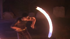 Man performing fire poi show Stock Footage