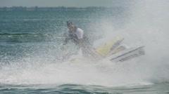 Man riding jet ski Stock Footage
