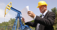 Engineer Extracting Specialist Looking Pumping Machinery Plans Oil Industry Stock Footage