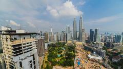 Kuala Lumpur cityscape Time lapse with dancing clouds, slide effect Stock Footage