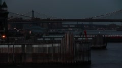 Ferry Docking with Brooklyn bridge in New York City East River Stock Footage