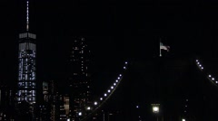 New York american flag on Brooklyn bridge one world trade center on the side Stock Footage