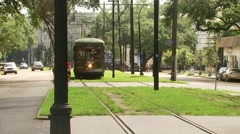 Tram passing on street Stock Footage