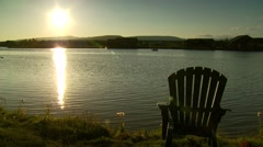 Empty chair on coast of lake at sunset in Pagosa Springs Stock Footage