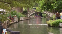 Tourists travelling on tour boat at San Antonio River Stock Footage