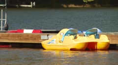 Moored paddle boat floating in river Stock Footage