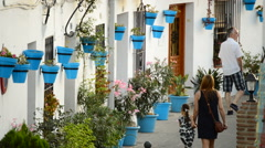 Tourists walking in a typical street village andalusian of Mijas at sunset Stock Footage