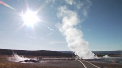 Tourists watching Old Faithful Geyser eruption in Yellowstone National Park - stock footage