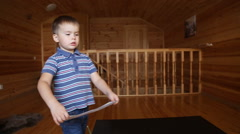 Little boy paints Stock Footage