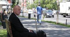 Concerned Businessman Meeting Delegation Travel Sidewalk Bench Sitting Wait Cab Stock Footage