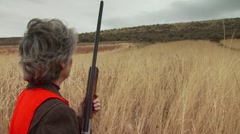 Hunter taking aim on pheasant while hunting - stock footage