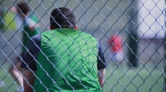 Soccer player sitting down during a soccer game - stock footage