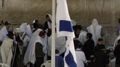 Stock Video Footage of Video of male Jews at the Western Wall filmed in Israel at 4k with Red.