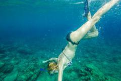Female snorkeling Stock Photos