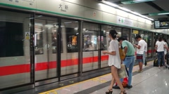 Shenzhen Daxin subway station interior landscape, passengers on the subway Stock Footage
