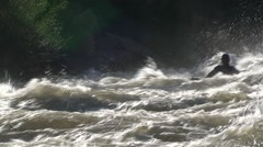 Kayak on a raging river Stock Footage