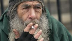 Sad and lonely old man smoking: closeup footage of homeless man Stock Footage