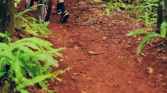 Young Man Walking Mountain Bike Uphill on Forest Trail.  Outdoor Sports Healt - stock footage