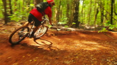 Intense Mountain Biking Follow Cam Shot Around Steep Dirt Berm Going Fast. Ou Stock Footage