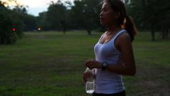 Activity woman run and break drinking water in park Stock Footage