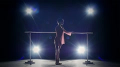 Little ballerina dancer near the barre. smoke. slow motion Stock Footage