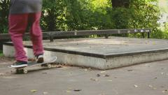 Skater does a manual (skateboard trick). - stock footage