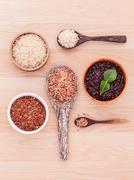 Collection of whole grain Thai jasmine rice,rice berry and brown rice best ri - stock photo