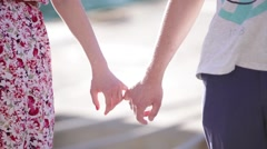 Hands holding on to little fingers Stock Footage
