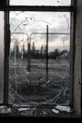 Smashed Glass Window Frame with Blurred Background - stock photo
