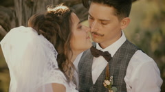 Portrait of bride and groom just married looking at each other Stock Footage