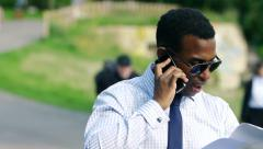 Elegant businessman arguing at the phone in the park Stock Footage