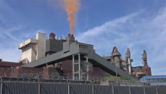 Steel plant producing red waste cloud - time lapse Stock Footage