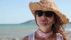 Young attractive woman in sunglasses and hat Stock Footage