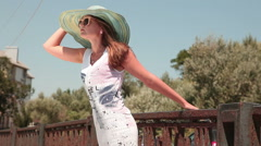 Young woman reaches for a breeze Stock Footage
