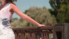 Young woman posing near the fence Stock Footage