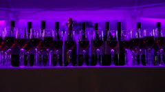A number of wine bottles and glasses on a wedding cocktail party Stock Footage
