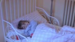 Little girl bed nightmare SL harassed relaxed Stock Footage