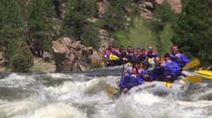 Rafters paddling through rapids Stock Footage