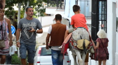 Tourists walking in a typical street village andalusian Stock Footage