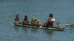 Papua New Guinea Woman with kids in traditional boat Stock Footage