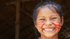 Native Brazilian girl at an indigenous tribe in the Amazon Stock Footage