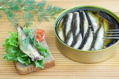 Sprats and tomatoes on a table Stock Photos
