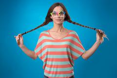 funny girl with pigtails - stock photo