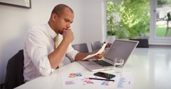 Tired African American businessman with a concerned look working at a office. Stock Footage