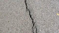 Broken Asphalt road surface Stock Footage
