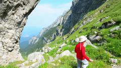 Kid walking on footpath up in the mountains - stock footage