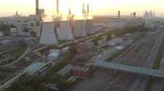 Stock Video Footage of Industrial area and railroad tracks at sunset. Aerial view
