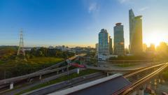 Time lapse: Sunrise view of Kuala Lumpur city beside the Federal Highway - stock footage